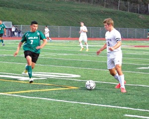 Naugatuck's Adam Branco (15) looks for room to work Oct. 8 in Naugatuck as the Greyhounds defeated Wilby, 3-1. Branco leads the Greyhounds with 23 goals through 11 games. –KEN MORSE