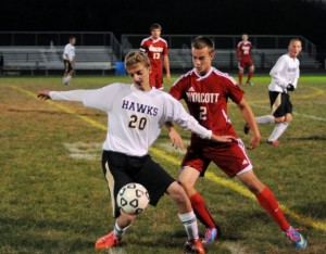 Woodland's Tristan Baxter (24) defends the ball against Wolcott's Cole Nelson (2) Oct. 21 in Beacon Falls. The Hawks won the game, 3-2. –LUKE MARSHALL