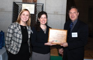 Beacon Falls First Selectman Christopher Bielik, right, is presented a plague by Katie Dykes, deputy commissioner of Energy for the Connecticut Department of Energy and Environmental Protection, as Rebecca Meyer, of CL&P, looks on Dec. 4 at the State Capitol in Hartford. –CONTRIBUTED