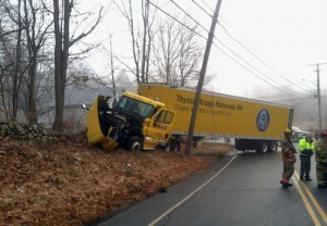 Officials respond to an accident on Route 68 at the intersection with Matthew Street in Prospect on Tuesday. The crash, between a tractor-trailer and Honda CR-V, sent two adults and two children to Saint Mary's Hospital in Waterbury. –CONTRIBUTED