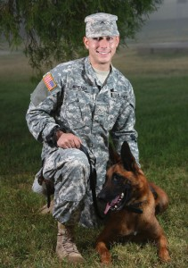 Army Pvt. Josef Arreaga, of Naugatuck, is pictured with Bruno, a 5-year-old German Shepherd military working dog, at the Department of Defense Military Working Dog School at Joint Base San Antonio, Texas, Dec. 4. -DEPARTMENT OF DEFENSE PHOTO BY EJ HERSOM