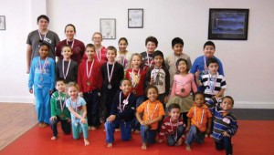 Sokol's Taekwondo recently honored students during its annual powerful words awards ceremony and pizza party. The ceremony is held for students who completed all 12 months of the powerful words character building lessons. Twenty-seven students were recognized and 19 gold metals and eight silver medals were awarded. –CONTRIBUTED