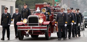 Beacon Falls firefighters march alongside Beacon Hose Company No. 1's 1929 Seagrave truck carrying the casket of former Fire Chief Roger Brennan on North Main Street Jan. 27 during Brennan's funeral procession. –ELIO GUGLIOTTI
