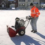Naugatuck Public Works Superintendent Robert Roland cleans snow off the portable ice skating rink Saturday morning on the St. Francis Church Field in Naugatuck before the rink officially opened. –LUKE MARSHALL