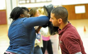 Naugatuck High School junior Sabrina Barbosa, left, practices the basics of Filipino Kung Tao with physical education teacher Anthony Loomis Jan. 24 during class. Loomis was named the 2014 Northeast region high school physical education teacher of the year by the Society of Health and Physical Educators of America. –LUKE MARSHALL