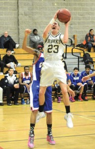 Woodland senior guard Tanner Kingsley (23) became the first player in the history of the boys program to score 1,000 points for his career on Tuesday when he scored 24 points against Holy Cross. The Hawks (1-5) are going through some growing pains this season but progressing as they do so. –FILE PHOTO