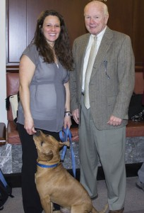 State Sen. Joseph Crisco, Jr. (D-17), right, meets Porkchop, a 1-year-old Shar Pei-Pitbull mix available for adoption through the Hartford-based Protectors of Animals, and the dog's handler during Voices for Animals Day in Hartford last month. –CONTRIBUTED