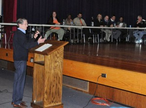 Youth and Family Services Advisory Board Chairman Dr. Geoffrey Drawbridge talks to the tri-boards of Finance, Education and Mayor and Burgesses about the agency becoming a non-profit organization Tuesday night at City Hill Middle School. –LUKE MARSHALL