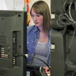 Woodland junior Ewelina Lemansky works at the video production switcher in the high school's new TV studio Jan. 31. –ELIO GUGLIOTTI