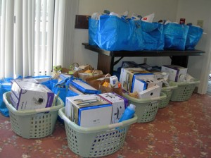 Basket and bags are filled with household items donated through the American Legion Auxiliary Unit 194's Baskets for the Homeless program. –CONTRIBUTED