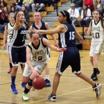 Woodland's Jenna Pannone (25) weaves her way through Ansonia defenders Kristina Fiallos (5) and Devon Champen (15) Feb. 7 in Beacon Falls. Pannone had seven points as the Hawks won the game, 49-29. –ELIO GUGLIOTTI