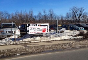 Cars are parked at one of Better Way Wholesale Autos' five auxiliary lots in Naugatuck. The auto dealer has proposed building a new facility in the Naugatuck Industrial Park. –RA ARCHIVE