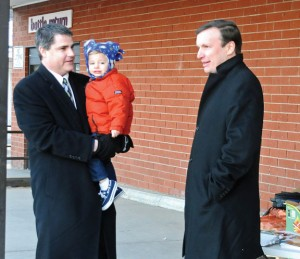 Naugatuck Mayor Robert Mezzo, left, with his son Jack talks with U.S. Sen. Christopher Murphy (D-Conn.) outside of the Stop and Shop on Rubber Avenue Feb. 28. –LUKE MARSHALL