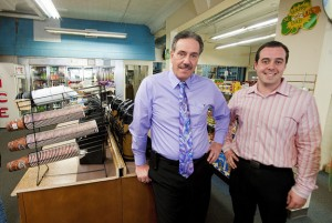Jerry Russo, left, former owner of Nelson's Pharmacy in Naugatuck, one of the two remaining family owned pharmacy's in Naugatuck, has sold his store to Gregg Hanson, right. The store is now G&A Variety owned by Hanson and his wife Alicia. –RA ARCHIVE