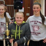 Justin DaSilva, 12, of Prospect poses for a picture with Naugatuck High School DECA officers Jessica Butler, left, and Angelina Piccirillo following the 7th annual Clash for the Cure March 27 at Naugatuck High. DaSilva has Ewings Sarcoma, a bone cancer. He has been the guest of honor at the annual staff versus students basketball game for the past three years. The game raises money for the high school's Pan Mass Challenge bike team, Blood, Sweat, Tears & Gears. The challenge is a fundraiser for the Dana Farber Cancer Institute. –ELIO GUGLIOTTI