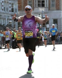 Beacon Falls resident Dino Verrelli crosses the finish line during the 2014 Boston Marathon April 14. –CONTRIBUTED