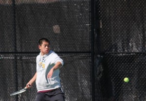 Naugatuck's Yun Chao Chen lines up a return shot during his match with Woodland's Mike Roulanaitis April 17 in Beacon Falls. –ELIO GUGLIOTTI