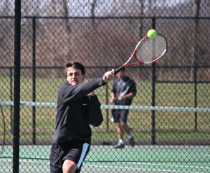 Naugatuck's Mike Popescu returns a shot during his match with Woodland's Pat Mulholland April 17 in Beacon Falls. –ELIO GUGLIOTTI