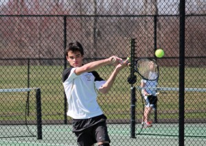 Woodland's Pat Mulholland returns a shot during his match with Naugatuck's Mike Popescu April 17 in Beacon Falls. –ELIO GUGLIOTTI