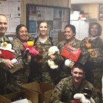 U.S. servicemen and women stationed in Afghanistan showoff some of the items received in care packages recently sent. The care packages were put together by Dolly Lengyel of Naugatuck with the help many individuals, organizations and businesses. –CONTRIBUTED