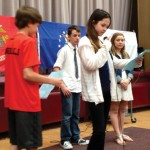 Hillside Intermediate School students read the names of veterans in their families during a Memorial Day ceremony May 23. More than 500 people attended the annual patriotic celebration.-PAUL SINGLEY