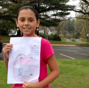 Kylie Simonds, 11, of Naugatuck, holds a rendering of her invention, the IPack, an IV backpack for children. She came up with the idea when going through cancer treatments at the age of 8. –RA ARCHIVE