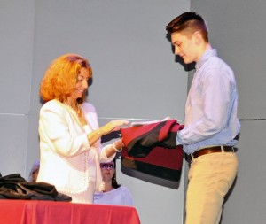 Naugatuck High School sophomore Lorant Sedenszki receives a jacket from Naugatuck High School Principal Jan Saam during a ceremony May 15 at the high school to honor sophomores, juniors and seniors who are academically in the top 5 percent of their class. –LUKE MARSHALL