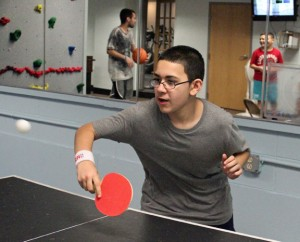 Xavier Nieves, 11, of Naugatuck plays a game of ping pong in the newly redesigned youth room at the Naugatuck YMCA May 15. –ELIO GUGLIOTTI
