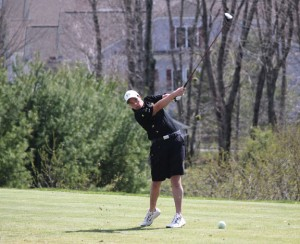 Woodland's Andy O'Dell tees off on the first hole April 28 at Oxford Greens in Oxford. Woodland faced Naugatuck on the links and the Hawks earned a 198-205 victory. –ELIO GUGLIOTTI