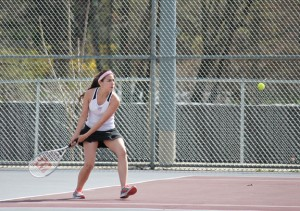 Naugatuck's Chelsea Iglesias lines up a forehand shot May 2 during a doubles match versus Holy Cross in Naugatuck. Iglesias and her doubles partner Kayla Rotatori won the match 8-4, as Naugatuck beat the Crusaders 4-3. –ELIO GUGLIOTTI