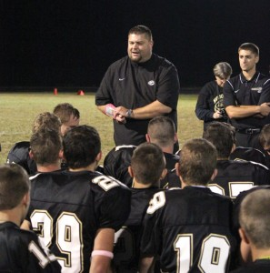 Woodland head football coach Tim Shea addresses the team last October after the Naugatuck game. Shea resigned as head coach May 2. –FILE PHOTO