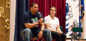 Former New England Patriots tight end Jermaine Wiggins, left, and farmer Melissa Greenbacker talk to City Hill Middle School students Monday at the school in Naugatuck about the importance of breakfast. –LUKE MARSHALL