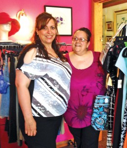 Rosemary Rodriguez, left, owner of Glam: A Consignment Boutique, stands with her cousin, Ana Fernandes, at the boutique on Church Street. –PAUL SINGLEY