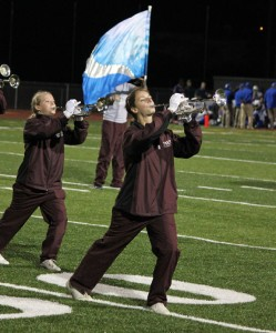 Members of the Naugatuck High School marching band perform at halftime of a football game last fall. –FILE PHOTO