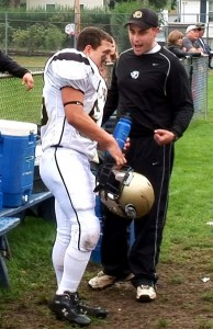 In this 2006 photo then junior varsity coach Tim Phipps, right, talks with Leandro Santos Jr. during a junior varsity game against Ansonia. Phipps, who has been with the Woodland football program since it began in 2001, has been named its new head coach. –RA ARCHIVE