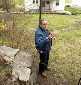 Vin Cascella describes the water problem on his property on Andrew Avenue in Naugatuck. –RA ARCHIVE