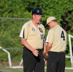 Posts 194-25 head coach Jeff Clarke, left, talks with Sam Merriman during the team's July 11 game versus Naugatuck. Clarke was named chairman of Zone 5 on July 1. –FILE PHOTO