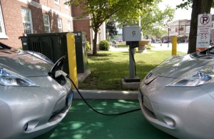 Two Nissan Leaf electric cars are parked outside City Hall in Torrington at a charging station in July. –RA ARCHIVE