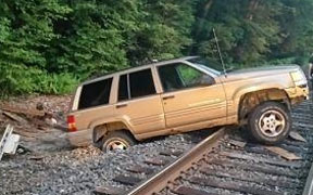 Stranded SUV disrupts train service