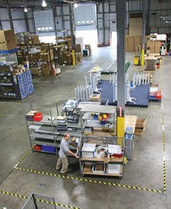 ITD Corporation employee Vick Ambrose pushes a cart across the company's warehouse at 80 Rado Drive in the Naugatuck Industrial Park. The company, which creates support systems for medical technology, moved from Prospect into the industrial park in July to expand its business. –LUKE MARSHALL