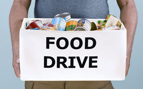 Cellular Connection holding food drive
