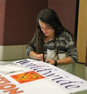 Woodland Regional High School senior Nicole Cina works on a sign for Woodland Worldwide's fifth annual Run for a Revolution Sept. 19 at the school in Beacon Falls. The event is Oct. 12 at Woodland. –ELIO GUGLIOTTI