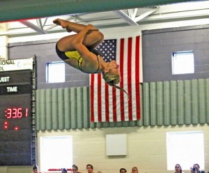 Woodland's Lauren Lombardo executes a dive Sept. 16 during a meet versus Holy Cross in Beacon Falls. –LUKE MARSHALL