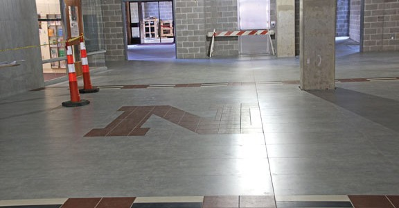 Work continues on the main entryway at Naugatuck High School. Over the weekend, the school will begin the next phase of the $81 million renovate-to-new project by bringing some classrooms in the North wing back online and beginning work on other classrooms in the wing. –LUKE MARSHALL