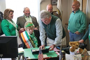 Prospect Irish Mayor of the Day Sally Murphy, surrounded by her family, watches as Mayor Robert Chatfield signs a proclamation to make her the mayor for the day on March 17 at Prospect Town Hall. –LUKE MARSHALL