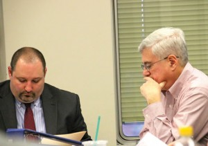 Naugatuck Assistant Superintendent of Schools Christopher Montini, left, and Board of Finance member Dan Sheridan look over the proposed 2015-16 Board of Education budget Monday at Town Hall. The Board of Finance postponed its vote on the spending plan until April 27 due to anticipated reductions. –LUKE MARSHALL