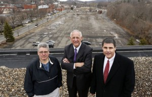 From left, Jay Carlson, chairman of the board of the Naugatuck Economic Development Corporation, Ron Pugliese, NEDC's president and chief executive officer, and Naugatuck Mayor Bob Mezzo stand for a photograph on top of the former General DataComm building in downtown Naugatuck last week. –REPUBLICAN-AMERICAN
