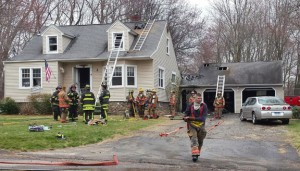 Firefighters work at the scene of a house fire at 4 Old Schoolhouse Road in Prospect on Sunday. A family was displaced after the fire. –REPUBLICAN-AMERICAN