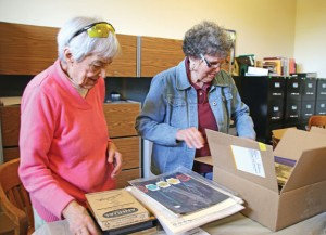 Naugatuck Historical Society volunteers Mary Doback, left, and Sandra Clark catalogue and pack historical documents May 14 in preparation for the museum's move from its current location at the former train station at 195 Water St. –LUKE MARSHALL