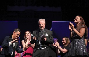 Naugatuck High School teacher Tim Reilly, center, is applauded following the DECA chapter's annual Rip the Runway show in 2014. Reilly, who is also the advisor for DECA, is this year's Raymond K. Foley Award winner. –FILE PHOTO